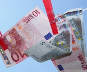 Stock photo - Money at clothesline